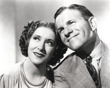 George Burns smiling with Woman