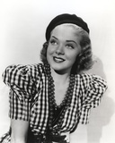 Alice Faye on Checkered and smiling
