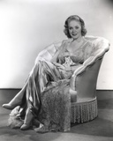 Alice Faye sitting on the Chair Legs Crossed