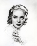 Alice Faye Looking at the Camera Holding Her Shoulder