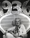 Alice Faye sitting on a Chair Showing a Smile
