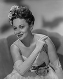 Olivia DeHavilland Seated in Gown with Gloves