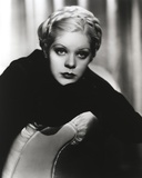Alice Faye sitting and Leaning on the Chair wearing Black Dress