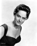 Alexis Smith Looking at the Camera wearing a Black Dress