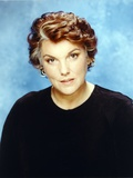 Tyne Daly in Black Sweater Skyblue Background Portrait