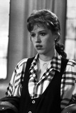 Molly Ringwald Portrait wearing Black vest with Plaid Sleeves