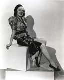Alice Faye on Checkered Top sitting and smiling Portrait