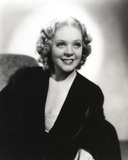 Alice Faye sitting on the Couch wearing Black Robe