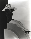 Alice Faye sitting and posed