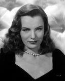 Ella Raines on a Necklace and Slightly smiling Portrait