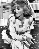 Connie Stevens sitting in White Dress with Pistol