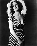 Bette Midler Posed Chin Up with Hand on the Skirt in Striped Deep V-Neck Dress