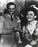 Billie Holiday smiling in Formal Suit Along with Woman