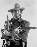 Clint Eastwood Posed in Cowboy Attire with Two Pistol