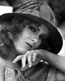 Bernadette Peters Close Up Portrait in Round Wool Hat and White Blouse with Head Leaning on the Han