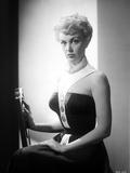 Jan Sterling Portrait in White Neck Strap Black Shoulder Dress with Left Hand on the Lap