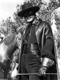 Guy Williams Riding Horse in Black Zorro Attire in Black Zorro Attire With Hat