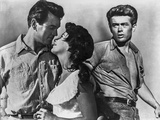 James Dean Posed in Grey Short Sleeve Shirt and Pants with Belt while Looking to the Right