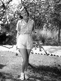 Jean Simmons Posed in White Striped Short Shoulder Shirt and White Short Pants