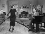 Al Jolson Playing a Piano While the Girl is Dancing in a Classic Movie Scene