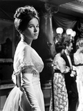 Geraldine Chaplin in White Gown with Curly Hair Side View Angle
