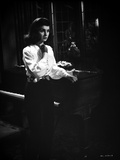 Jean Simmons Posed in White Long Sleeve Poet Shirt and Black Straight Cut Pants