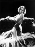 Jane Wyman Posed and Seated on the couch in White Silk Halter Dress with Hands on the Top Railing