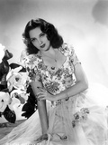 Linda Darnell sitting wearing Floral Dress in Black and White
