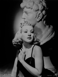 Betty Grable Portrait with Hands on the Chest near the Neck in Black Strap Velvet Dress