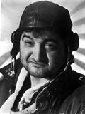 John Belushi wearing a Motorcycle Hat and a Black Jacket in a Close Up Portrait