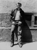 James Dean Posed in Black Velvet Long Sleeve Jacket and Jeans while Leaning on the Wall
