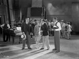 Al Jolson Discussing in a Group Inside the Studio in a Classic Movie Scene
