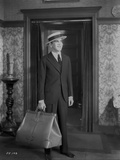 Al Jolson Leaving with a Big Bag wearing a Black Suit and a Hat Classic Movie Scene