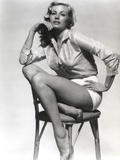 Anita Ekberg sitting on a Chair wearing a Glossy Long Sleeves in a Classic Portrait
