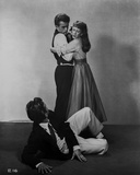 James Dean East of Eden standing in Black Vest and White Long Sleeve while Hugged by a Woman
