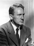 Spencer Tracy Cast Member Looking Away wearing Formal Suit in Black and White Portrait
