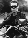 Arnold Schwarzenegger Riding a Bike in Black Leather Jacket