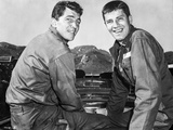 Dean Martin and Jerry Lewis Scene with Two Men Carrying Something Heavy in Black and White