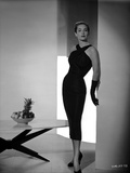 Vera Miles wearing a black  cocktail length  crossed-halter dress