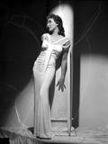 Jean Parker Posed in White V-Neck Short Sleeve Gathered Dress