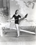Janet Leigh Posed in Black Linen Unitard and White Belt with Right Leg Raised Forward
