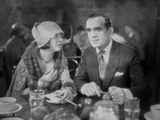 Al Jolson Eating with a Woman in a Restaurant in a Classic Movie Scene