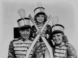 Shirley Temple Taking a Group Picture wearing a Guard Outfit