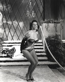 Jane Russell Posed in Black Velvet One Piece Sexy Suit and Black Shoes