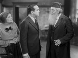 Al Jolson Talking Seriously with A Man with Beard in a Classic Movie Scene