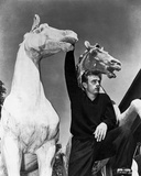 James Dean Posed in Black Long Sleeve V-Neck Shirt with Right Hand Holding on a White Horse Figure