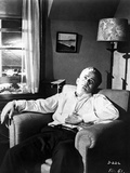 James Dean Seated and Leaning Back on a Couch in White Long Sleeve Collar Shirt