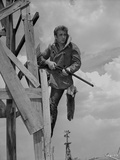 James Dean Posed in Fur Collar Velvet Long Sleeve Coat with Hands Holding a Rifle