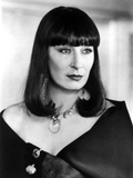 Anjelica Huston Looking the Left wearing a Black Blazer with Necklace in Classic Portrait