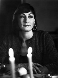 Anjelica Huston sitting at the Dining Table wearing a Loop Earring Portrait in Classic
